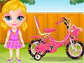 Малышка Барби катается на велосипеде